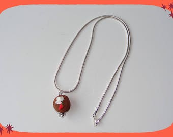 Snake with its chocolate macaron pendant necklace