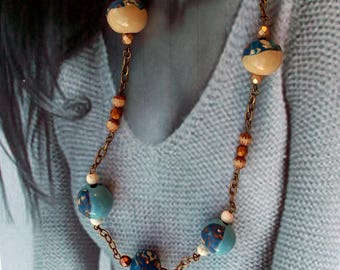 Necklace with beads in shades of blue, beige, terracotta and ochre polymer clay