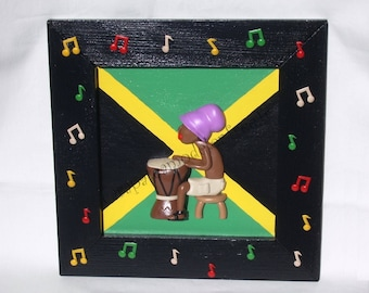 Jamaican decorative table playing the djembe