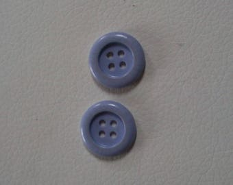 Small simple purple plastic buttons