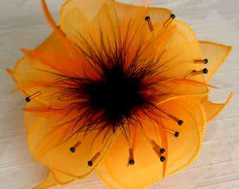 Flower brooch in yellow silk fabric, feathers and beads