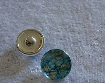 Snap flowers blue background under glass magnifying glass 18 mm