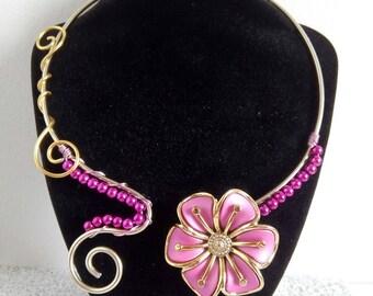 Pink and gold aluminum collar...