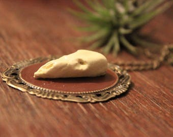 Polymer clay skull cameo necklace