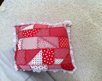 Crazy red hand embroidered pillow