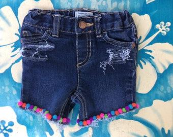 Hand distressed denim Pom Pom shorts
