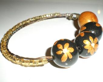 Black and gold asymmetrical beaded bracelet