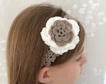 With its White/taupe flower crochet headband