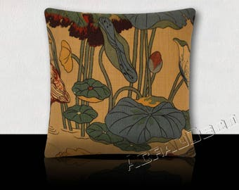 Design pillow in turquoise/green/yellow/plum blue lilies on a beige background.