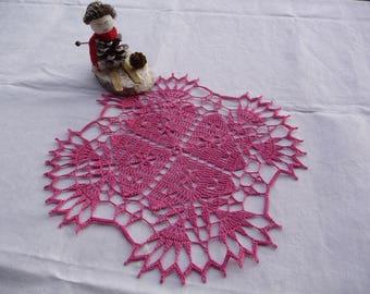 Handmade fuchsia pink cotton crochet lace doily.