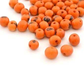 10 orange round beads 6-10mm Acai seeds