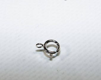 Silver 6 mm, round, spring ring clasp. Money first.