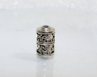 Silver bead tube 13 by 7.5 mm wire and micro dots decoration.  Money first.