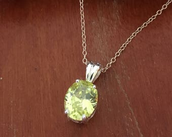 Sterling silver CZ peridot green pendant with spiral detail