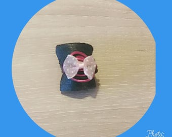 Pink and black ring with a bow