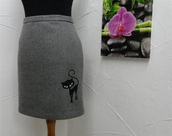 Straight skirt is grey with embroidered black cat