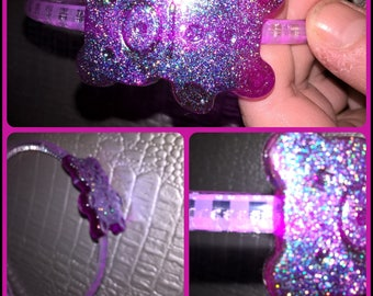 Translucent thin headband with a resin bear and purple stripes