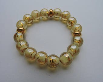 elastic bracelet gold spacers and gold murano beads