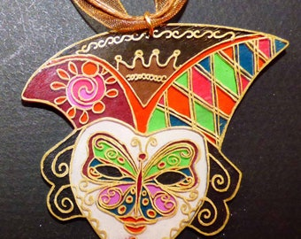 Venetian mask with butterfly-inspired pendant