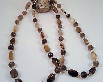Elegant gemstone necklace made of petrified wood, smoke quartz and silver elements 925