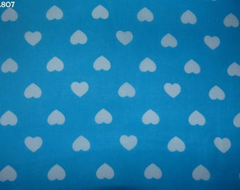 Fabric C807 white hearts on turquoise coupon background 35x50cm