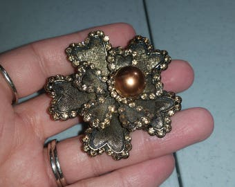 Bronze gold colored brooch