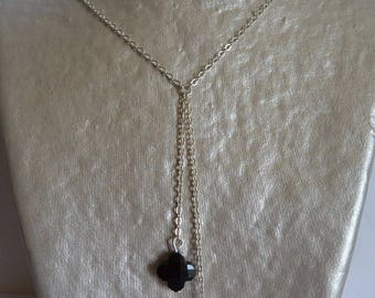 Double black clovers suspended on silver chain necklace