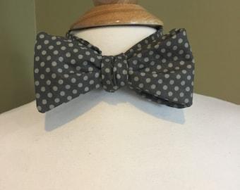 Cecil's dark gray polka dot bow tie