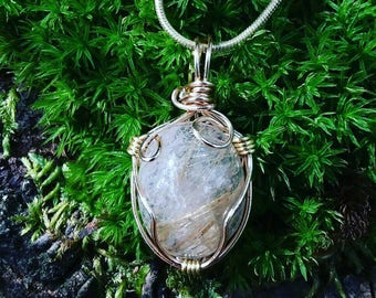 Dainty, golden rutilated quartz cabochon.