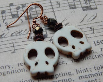 White magnesite skull-shaped earrings.