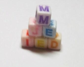 Multicoloured  baby blocks for dollshouse  nursery