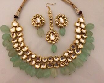 Mohini grapes green beaded kundan necklace set with earrings and tika