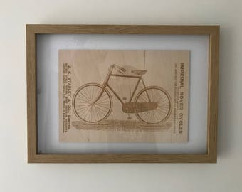 Antique Cycling/Bicycle Advertisement engraved onto birch plywood.