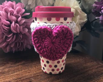 Handmade raspberry pink and light grey crochet heart coffee cozy perfect for Valentines Day