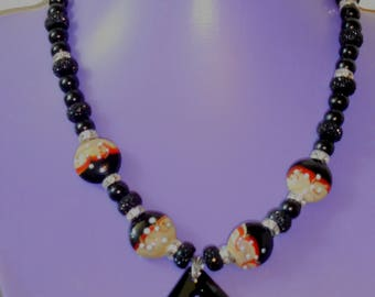 Breathtaking black necklace enhanced with exquiste focal beads