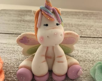 Polymer clay- Cold Porcelain Unicorn Cake Topper.