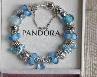 Authentic Pandora bracelet with Genuine sterling silver ''925'' charm beads