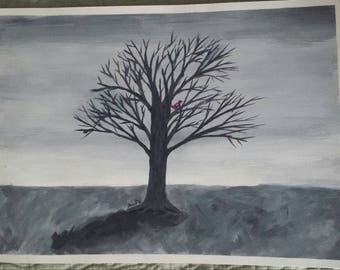 Grey tree with red bird