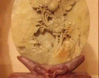 Vintage hand carved soapstone medallion on stand