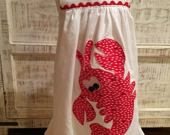 Sundress: White textured cotton sundress with lobster appliqué and shoulder ties.
