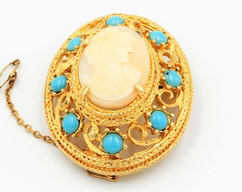 Vintage brooch gold tone domed filigree mount with cameo and imitation turquoise