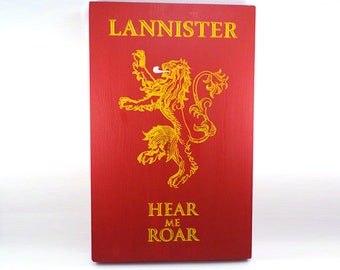 Wood engraved coat of arms (emblem) of the House of Lannister. Game of Thrones.