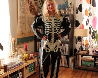 1980s vintage adult skeleton costume, full body suit by Ben Cooper 1983 . APPROX mens medium, womens large . NOS 80s Halloween