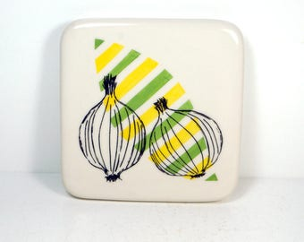 tile in yellow & green with an onions print. ready to ship