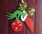 The Grinch Christmas Door Hanger with a Whoville Ornament