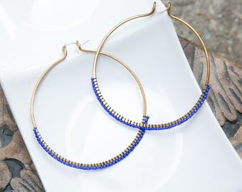 Hand hammered bronze hoops with cobalt blue beading and sterling silver earwires