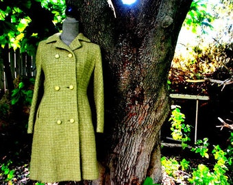Mod vintage 60s, olive green, buckle , wool  , double breasted coat.  Made by Sycamore. Size 6