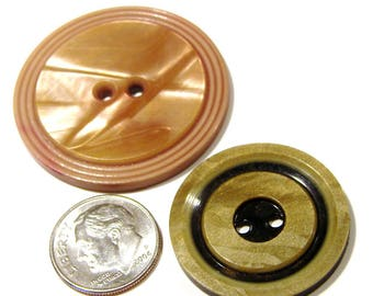 Two Celluloid Buttons - Beautiful Rosy Colored One