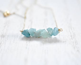 rough aquamarine bar necklace. gold filled chain. rough unpolished aquamarine gemstone bar. rough aquamarine jewelry. organic rustic