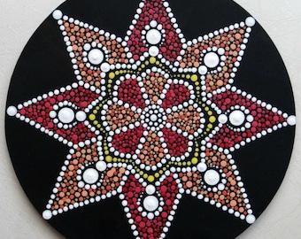 Round star-shaped mandala painting, dot painting, dot art, dotillism, eight branches star